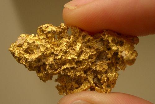 Тройская унция золота
